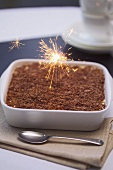Tiramisu with burning sparkler