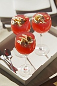 Rhubarb & honey jelly with flaked almonds in three glasses