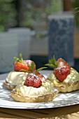 Three strawberry & clotted cream tarts, with marinated strawberries