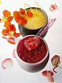 Red and yellow fruit cocktails with flowers