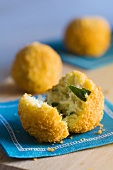 Deep-fried fish balls, two whole and one halved