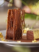 Chocolate dessert with gold leaf