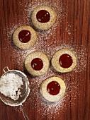 Five Husarenkrapfen (Hussar cookies) dusted with icing sugar