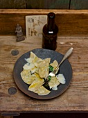 Schlutzkrapfen mit Spinatfüllung, Parmesan und Buttersauce