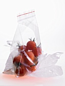 Frozen cherry tomatoes in a freezer bag