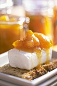Fresh goat's cheese with sweet & sour apricots on brown bread