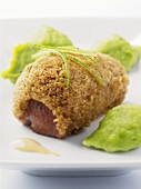 Loin of lamb baked in a crust with pea puree