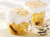 Apple compote with browned meringue in glass cups