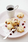 Star-shaped cranberry shortbread cookies with a cup of coffee