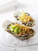 Two baked oysters with leeks on a bed of salt