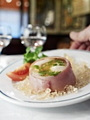 Serving egg in aspic with ham in a restaurant