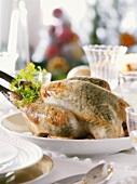 Whole poularde on festive table