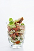 Bread, cucumber and tomato salad with basil in a glass