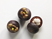 Mangosteens, two whole and one half