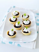 Seven small balsamic onion tarts