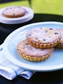 Four blueberry tarts
