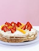 Hazelnut meringue with strawberries, peaches & whipped cream