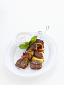 Grilled lamb and pepper kebabs with minted yoghurt dip