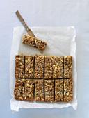 Cut wholemeal nut muesli bars on a baking tray