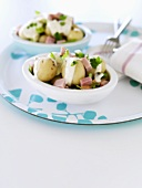 New potatoes with ham and sour cream