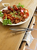 Dried and fresh tomatoes with basil dressing