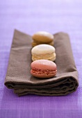 Three filled macarons on a fabric napkin