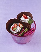 Strawberry cream with strawberries in two chocolate cones