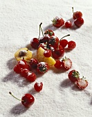 Berries, cherries, pieces of apricot and peach on sugar