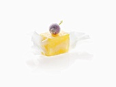 Molecular cuisine: mango in milk paper with frozen berry