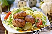 Burgers on salad with dill potatoes