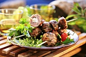 Meatballs stuffed with feta cheese, grilled on skewers