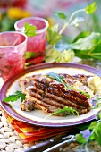 Grilled pork neck steak with rocket and mayonnaise
