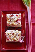 Two pieces of rhubarb crumble cake