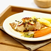 Saddle of rabbit with carrots and potatoes