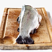 A trout on a wooden board