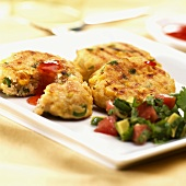 Fish cakes with tomato and avocado salsa