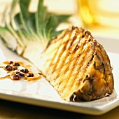 Grilled pineapple quarter & orange sauce with pink peppercorns