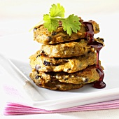 Five pumpkin and elderberry pancakes with maple syrup