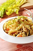 Spiral pasta with cod and celery