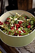 Cranberries with leaves and twigs in a tin