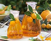Orange vinegar in two glass carafes