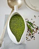 Rocket, coriander and parsley sauce in a sauce-boat