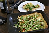 Vegetarian pizza with rocket & ricotta topping in baking tin