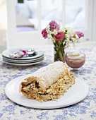 A meringue roulade with cream and hazelnut filling