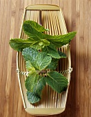 Mint in a small bamboo basket