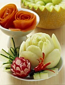 Carved vegetables and melon balls in a melon