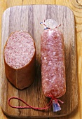 Two different types of Mettwurst (pork sausage) on wooden board