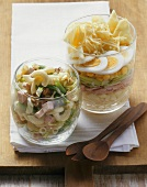 Pasta salad and ham and leek salad in glasses