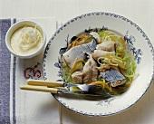 Carp in vegetable stock with frozen horseradish