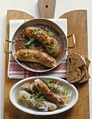 Sausages in beer sauce and in 'sour' stock